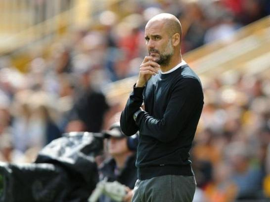 1535213587-Guardiola-calm-despite-Man-City-stumble-against-Wolves-AP
