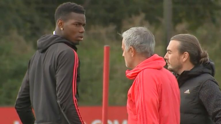Paul Pogba and Jose Mourinho on the training pitch during their much-publicised feud on the Manchester United training pitch