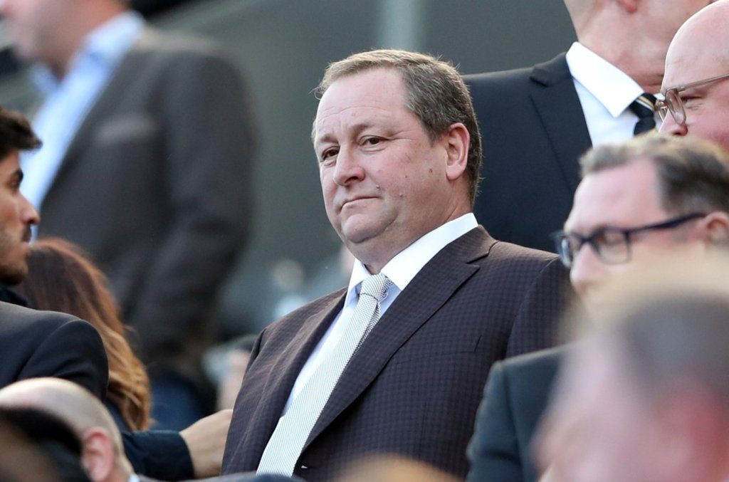 Mike Ashley, owner of Newcastle United, watches on.