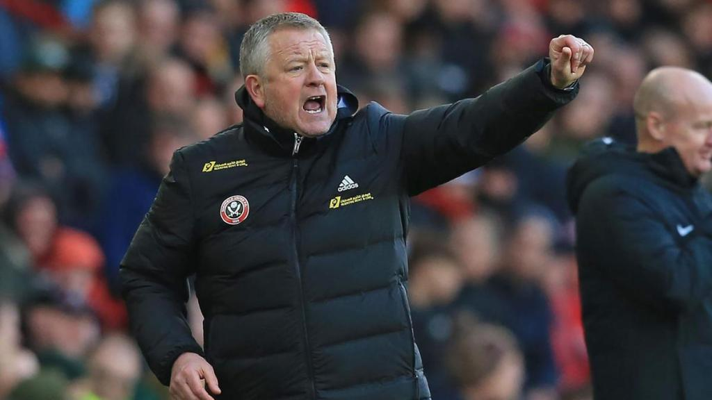 Chris Wilder celebrates a goal in the Premier League for Sheffield United