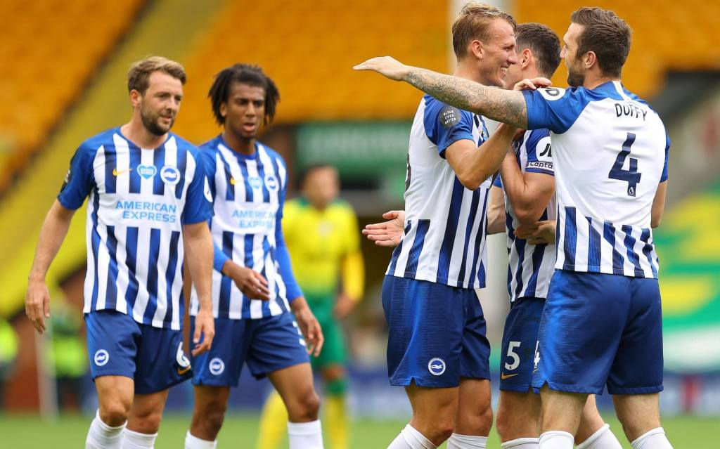 Brighton & Hove Albion players celebrate after scoring against Norwich City in the Premier League